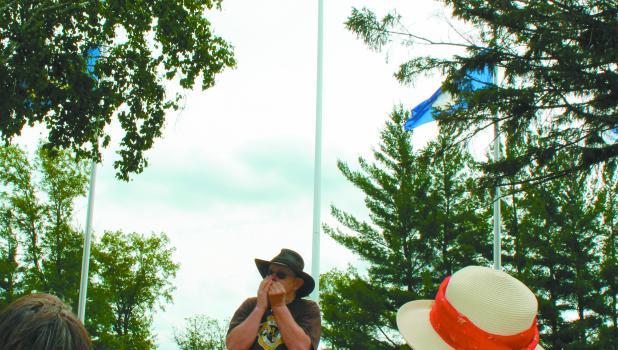 "army veteran Tom Stetzler of Staples plays ""The Battle Hymn of the Republic"" on his harmonica."