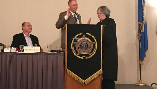 Wadena County Sheriff Mike Carr became the Minnesota Sheriffs Association President, sworn in by Judge Sally Ireland Robertson. At left is outgoing MSA President Richard Stanek, Hennepin County Sheriff. (Submitted photo)