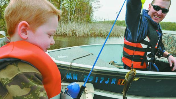 Joshua Winter and his son, JJ spent some quality time fishing for sunnies at Dower Lake near Staples on May 9. JJ pulls up a sunny with dad's help while fishing from the southeast part of the lake.