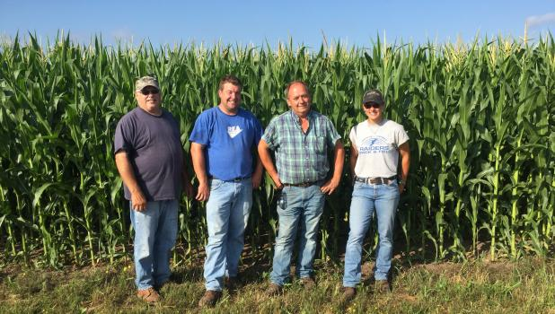 CLC Ag Center staff from left, Bruce Berg, Lance Perius, Ron Nelson, and Hannah Barrett, in front of one of their corn plots at the college. The Aug. 25 Field Day will include a corn demo, and plot testing. (Submitted photo)