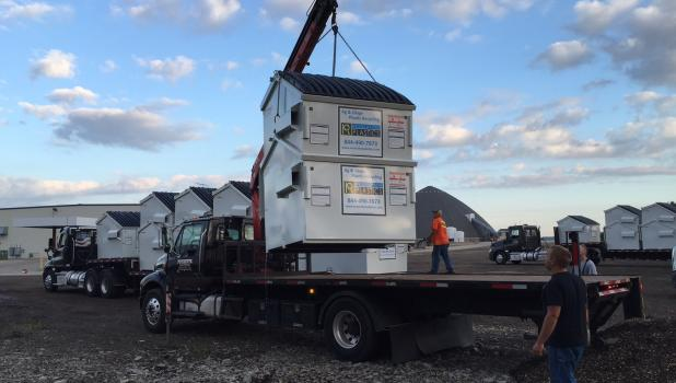 Farm recycling dumpsters being delivered in Winona County. The Central Minnesota dumpster hub is located at the Pope County Fairgrounds in Glenwood. (Submitted photo)