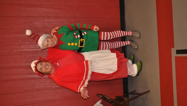 Mrs. Claus (Becky Hasselberg) and elf (Jude Vrdoljak) drew names for lucky prize winners at the Christmas party.