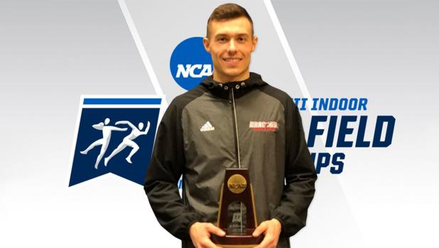 Brian Huber with his third place trophy from the NCAA Division II Indoor Nationals.