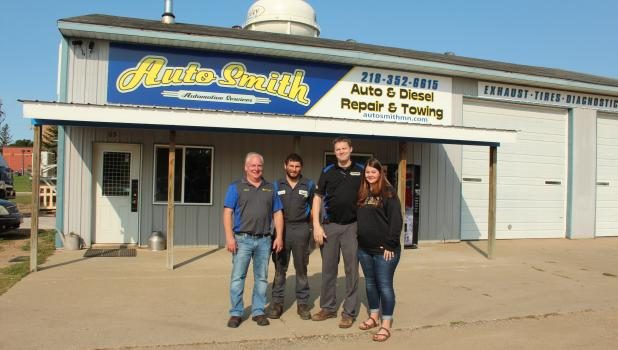AutoSmith, with shops located in Ironton and McGregor, has recently opened in Motley. Owned by Dustin and Julie Smith of Ironton, AutoSmith is located at 65 Cemetery Road, just off of Hwy 10 South in Motley. Pictured above, from left, are Jason Franzen, Service Manager; Clint Tienter, technician; and Dustin and Julie Smith. (Staples World photo by Dawn Timbs)