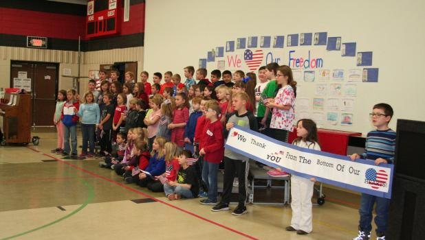 During their Veterans Day program Nov. 11, Staples-Motley Elementary School students sang songs, read essays and offered a special tribute to veterans to show their appreciation for the veterans' service to the United States. Prior to the program, the veterans were served breakfast in the school's cafeteria. (Staples World photo by Dawn Timbs)