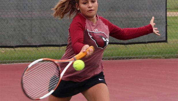 Kearra Kern, above, played at number two doubles in the conference tournament