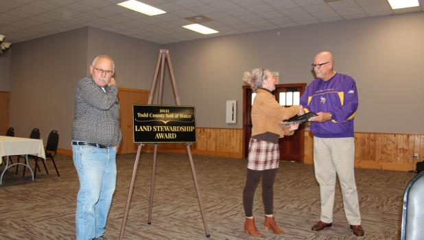 The Todd County Soil and Water Conservation District (SWCD) Board of Supervisors held their annual awards banquet Oct. 14, at Timbers Event Center in Staples. Above: Deja Anton, Todd County SWCD District Manager, presents the 2021 Land Stewardship Award to Greg Frisk of Motley. Below, from left, Lynette and Jim Waldorf, farmers in Todd County, received the 2021 Conservationist of the Year award from Dale Katterhagen, Todd County SWCD Board Chair. (Staples World photos by Dawn Timbs)