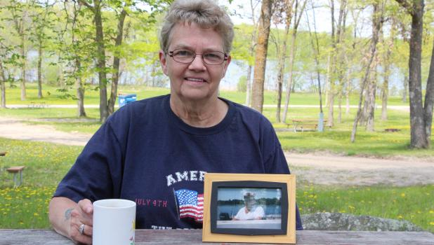 Shirley Olson keeps a photo of her husband Arnold with her when she goes camping at Dower Lake. The two started camping there regularly about 15 years ago, and since Arnold passed away five years ago, Shirley continues to come back to the campground they loved so much.