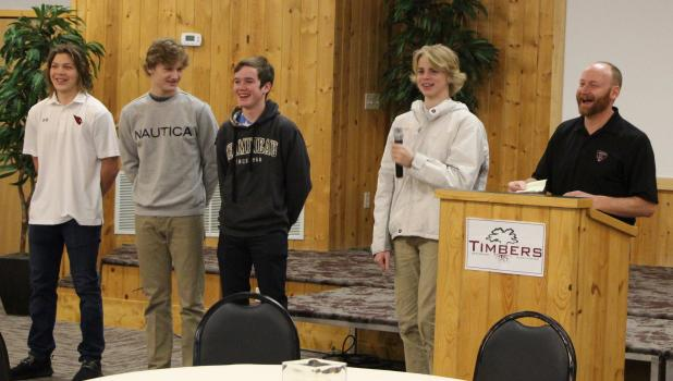 Staples-Motley students on the Wadena-Deer Creek hockey team share a laugh at the Cardinal Coffee on Feb. 7. From left are Cade Schmidt, Cael Sams, Gabe Misner and Finn Erholtz and coach Scott Woods. (Staples World photos by Mark Anderson)