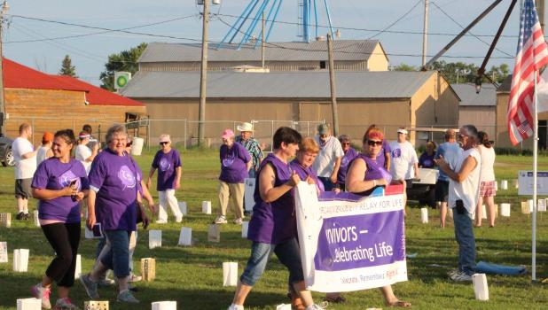 Relay For Life attendees lined the course to applaud for cancer survivors as they took their lap at the Staples Motley Relay For Life.