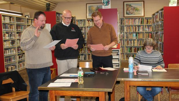 Three members were elected to the Staples-Motley School Board Nov. 8 and they took their oath of office at the board's organizational meeting Jan. 3. From left are Bryan Winkels, Greg Frisk and Chad Longbella. Seated is Mary Freeman, board chair. (Staples World photo by Brenda Halvorson)