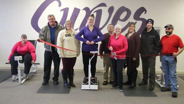 Celebrating the new ownership of Curves in Staples are Staples Motley Area Chamber of Commerce members, Curves staff and the family of new owner Jeanette Evans. From left, Jen Selvaag, Dan Orth, Britney Bursch, Mary Osborn-Whitney, Randy and Jeanette Evans, Tammy Johnson, Steve Gertken and Bruce Brotherton. The public is invited to Curves open house Jan.14-18 to acknowledge the new ownership. Curves hours are 6 a.m.-1 p.m. and 3:30-6 p.m. (Staples World photo by Mark Anderson)