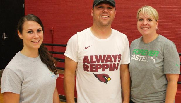 From left, Staples-Motley assistant coaches Ashley Rubner and Cy Bestland with Head Coach Gretchen Bestland.