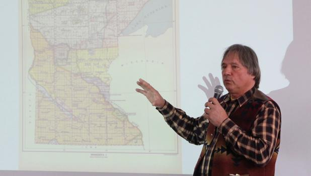 Don Wedll points to a treaty map showing different areas sold to settlers by the Native Americans in Minnesota. (Staples World photo by Mark Anderson)
