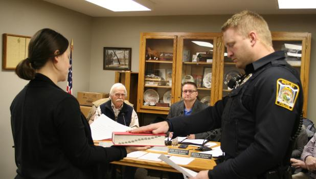 Josh Pesta, Motley Police Officer, took the oath of office Feb. 11, at the Motley City Council's regular meeting. Also pictured, from left, are Lacey Smieja, City Clerk/Treasurer who led the oath of office; council member Pat O'Regan; and Mayor Al Yoder. Officer Pesta began his duties with the Motley Police Department on Feb. 4. (Staples World photo by Dawn Timbs)