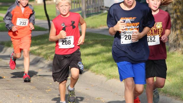 Kids were free to run fast and have fun at the Railroad Days Junior Dash on Aug. 27. (Staples World photos by Mark Anderson)