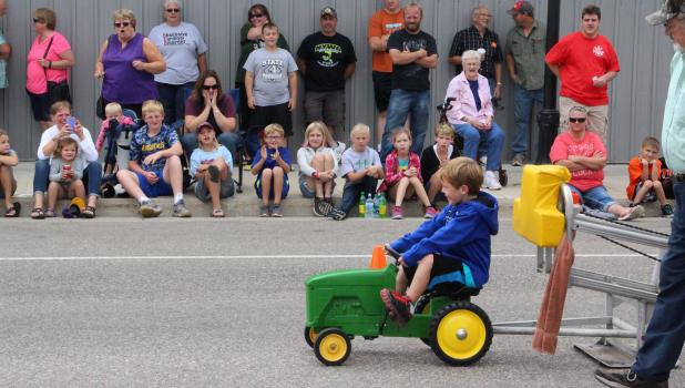 On lookers cheered for their favorite pedal puller during the Railroad Days competition on Aug. 27. (Staples World photo by Mark Anderson)