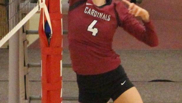 Camryn Banaka tips a ball over the net.