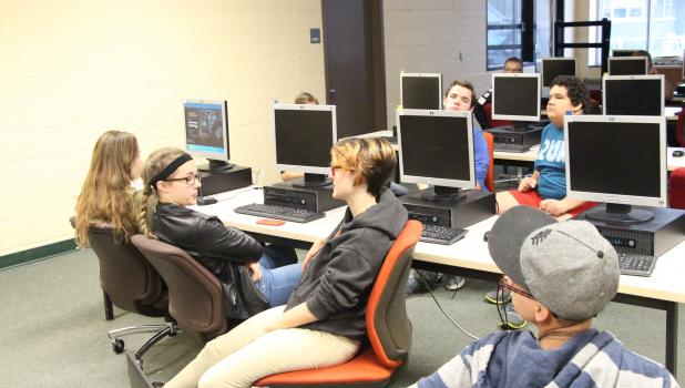 Dispelling the notion that only boys play video games, several girls are part of the Staples-Motley League of Legends team. Pictured from left, Samantha Ratajczak, Hope Ratajczak, Chelsea Hofmann and Xena Mason. (Staples World photo by Mark Anderson)