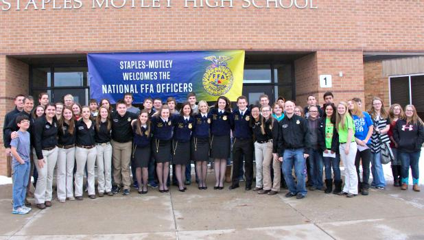Staples Motley FFA members welcomed the national FFA officers and members of the Deer River FFA on Jan. 8, shown here in a photo op, in front of the high school.