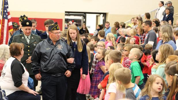 Staples-Motley FFA students escorted veterans into the Veterans Day program held at S-M High School Nov. 11, as elementary school students watch the procession.