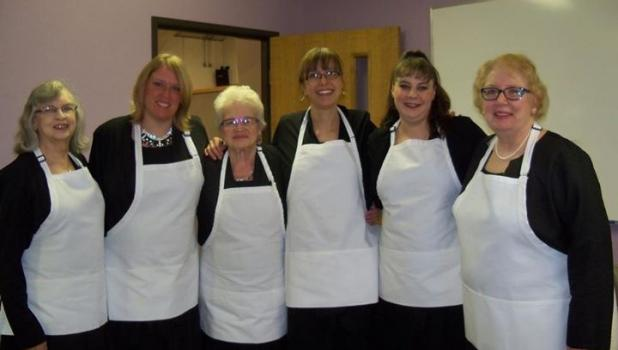 A few members of the Staples Area Women's Chorus paused for a photo before serving lunch at the 2015 Soup, Sandwich and a Song event. This year's lunch and concert is Oct. 29. From left are Dorothy Koopman, Carrie Patterson, Louise Drajna, Anne Freelove, Wendy Hansen and Kay Howell. (Submitted photo)