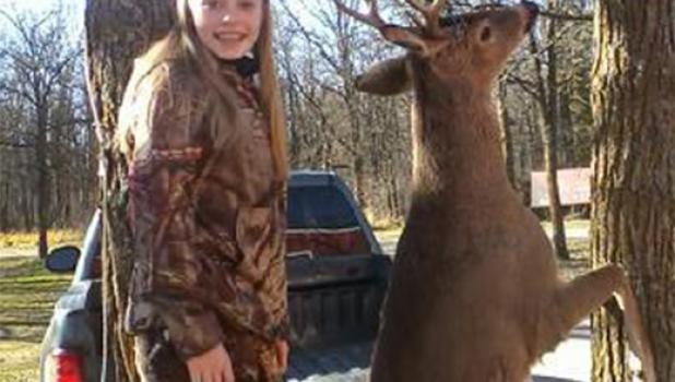 """Anna Meech, 13, from New York Mills, shot this nine-point, 129 pound buck near Nimrod the morning of Nov. 13. """"It was about 7:30 a.m.,"""" she said, adding that she was hunting with her dad, Ross Meech. Anna is pictured at Wahoo Valley in rural Staples, at which she won the """"Big Buck Contest"""" the previous year. (Staples World photo by Dawn Timbs)"""