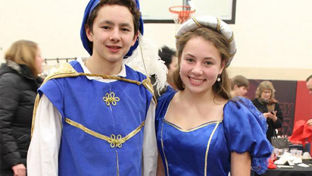 At the last Madrigal Dinner held in 2014, Noah Han escorted Katie Benson as part of the King's Royal Court. As  seniors this year, they a long with students in grades 8 -12 will welcome guests to the King's Madrigal celebration at Staples-Motley High School, Dec. 3 and 4. (Submitted photo)