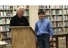 Alex Brings, right, a Staples-Motley High School student, shared his story of hard work, encouragement and successes, despite being legally blind during the Staples-Motley School Board meeting May 21. His talk earned a standing ovation from the board and audience. Frank Odell, left, has worked with Brings as a speech coach. (Staples World photo by Brenda Halvorson)