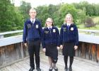 At camp, left to right are: State Treasurer Adam Kroll, Lexie Tweeter, Staples-Motley FFA and Region 2 President Madeline Hinrichs. (Submitted photo)