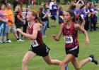 Ashley Robben and Kyanna Burton race to the finish line after running together for the 5,000 meter race. (Staples World photo by Mark Anderson)
