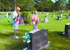 Jack Wilson and Michelle Ziegler, Staples were among the volunteers placing flags on the graves of veterans at Evergreen Hill Cemetery in Staples on May 23. The flags will be on the graves through Memorial Day. The Memorial Day program at Evergreen Hill begins at 9 a.m. on May 30 with speaker Andy Schmidt.