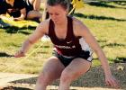 Amber Robben lands in the sand during the long jump.