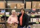 risk receives a $500 check from Fran Kunkle on behalf of First International Bank of Motley. The bank also donated a cart full of canned goods. (Submitted photos)