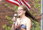 Macy Judd throws her hair and her voice into the wind during the Staples Sings! contest Aug. 27. Judd placed first,