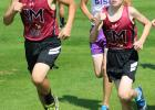 Jack Tyrrell and Hunter Klimek team up in the cross country race. (Staples World photo by Mark Anderson)