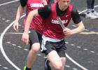 Zac Carlson hands off to Chase Davis to win the 4x100 relay