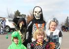 A number of costumed children collected bags of candy at the Trunk or Treat event in Motley Oct. 27. It was organized by volunteers representing local churches, the Staples Motley Area Chamber of Commerce, individuals and the City of Motley. Pictured above, back row from left, are Caleb Burton, Samuel Tauber and Emma Burton. Front row: Kirra Burton and Leah Burton, all from Hewitt.
