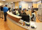 The new nurses station at the Lakewood Health System emergency department allows nurses to do their work, even while media interviews are being conducted, construction continues and security personnel are working on the new monitoring system. (Staples World photo by Mark Anderson)