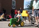 "Four-year-old Jaxon Dause of Staples took second place in his age group at the Railroad Days Pedal Pull. He pulled a total of 9'11"". (Staples World photo by Dawn Timbs)"