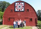 "It took a lot of people to achieve the status of getting a barn quilt on the 2019 national calendar. Some of those involved gathered on July 27 to celebrate the achievement. The photo for the calendar was taken by Lisa Jenkins, second from right, and submitted to the calendar contest by Lisa Kajer, far right. Also in the photo, barn owners Kathy and Max Sibbert, who requested the ""American Star"" quilt that was painted by Judy Halverson, standing with her husband Art, who used to live on the farm. Also pictu"
