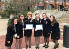 Two Staples-Motley FFA alumni received the highest award in FFA, the American Degree, at the National FFA Convention in Indianapolis Oct. 24-27. Hayley Carlson and Rebekka Paskewitz show their awards with their FFA supporters. From left are Molly Lindgren, Rachel Paskewitz, Carlson, Rebekka Paskewitz, Olivia Leslie and Kai Gelle. (Submitted photo)
