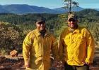 Motley Firefighters Nick Dille (left) and Bryan Stevens spent ten days in Oregon helping to fight the wildfires there, along with six days of round-trip travel. They worked a total of 222 hours during that time. They are pictured near Hope Mountain in Oregon during a break.