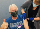 Tim Ludwig, a nurse at Todd County, was excited to receive his first dose of the COVID-19 vaccine from nurse Ronni Turchin. (Submitted photo)