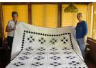"The Piecemakers Quilt Club will have a Bed Turning and will offer mini-classes at the Landmark Inn during the Weaving Waters Fiber Arts Trail weekend, Sept. 21 and 22. This event is free to the public.Tickets will also be available for ""Duty, Honor and Country,"" the group's raffle quilt. The raffle quilt was made from the stash of the late Lorna Wiens. For more information contact Lisa Kajer at 218-894-2906. Pictured with the quilt ""Duty, Honor and Country"" are Judy Droubie and Annette Good. (Submitted phot"